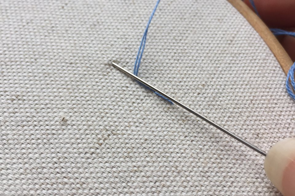 Needle as ruler for embroidery stitches