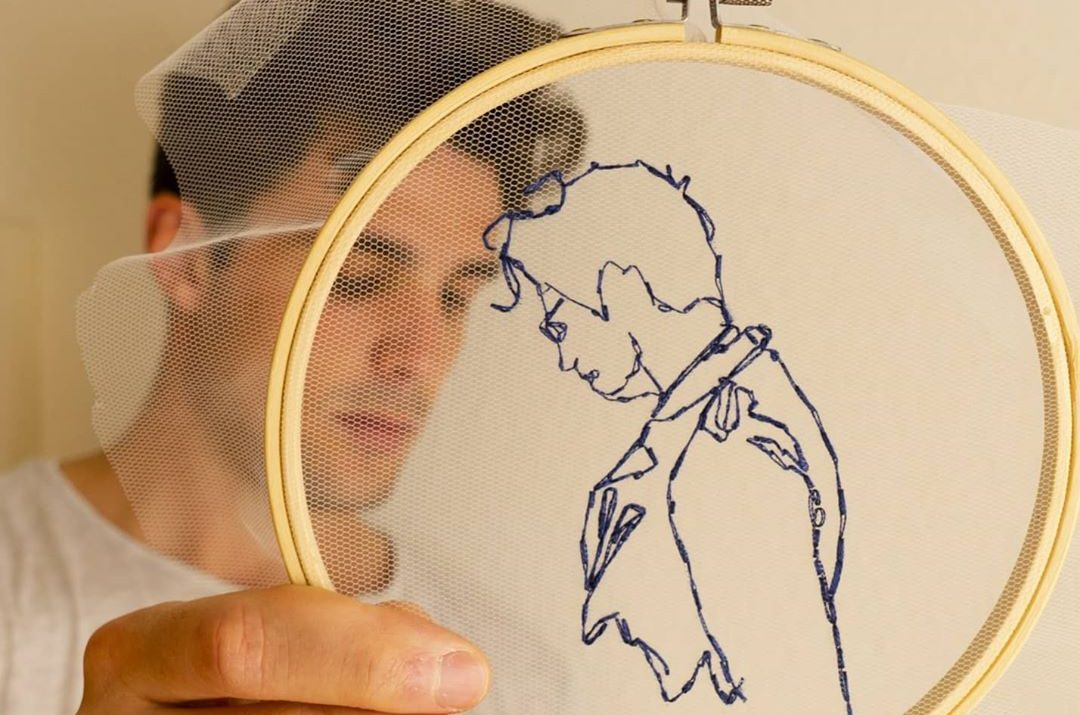 Self portrait embroidered on tulle